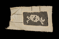 2009.376.21_a front Four white filet embroidered net inserts brought to the US by a Jewish family fleeing German occupied Poland  Click to enlarge