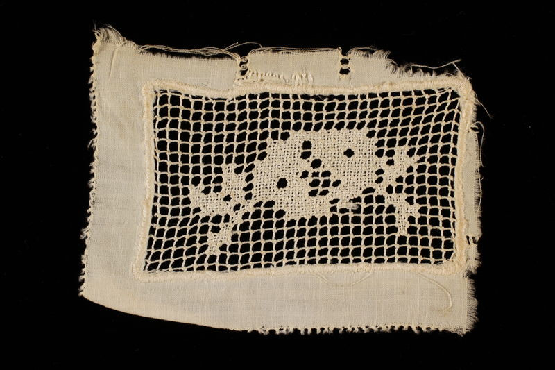 2009.376.21_c front Four white filet embroidered net inserts brought to the US by a Jewish family fleeing German occupied Poland