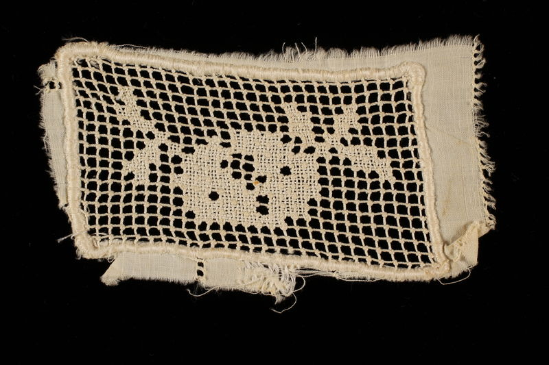 2009.376.21_d front Four white filet embroidered net inserts brought to the US by a Jewish family fleeing German occupied Poland