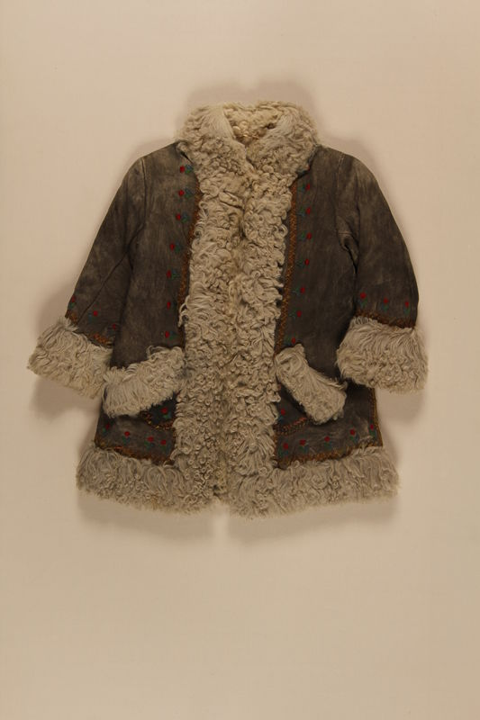 2009.376.22 front Child's gray shearling embroidered mountaineer's craft coat brought to the US by a Jewish family fleeing German occupied Poland