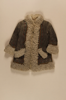 2009.376.22 front Child's gray shearling embroidered mountaineer's craft coat brought to the US by a Jewish family fleeing German occupied Poland  Click to enlarge