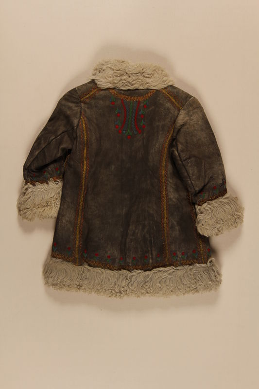2009.376.22 back Child's gray shearling embroidered mountaineer's craft coat brought to the US by a Jewish family fleeing German occupied Poland