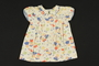 Child's colorful print cotton dress with blue piping brought to the US by a Jewish family fleeing German occupied Poland
