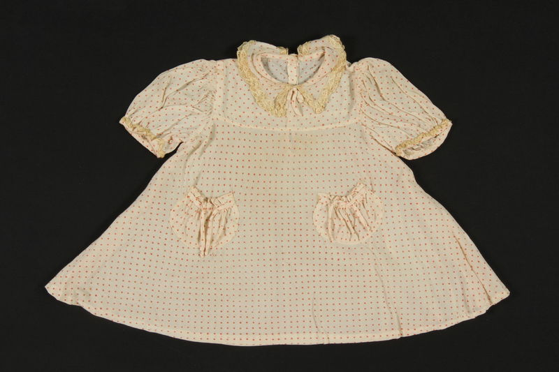 2009.376.24 front Child's peach silk polka dot dress brought to the US by a Jewish family fleeing German occupied Poland
