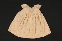 2009.376.26 front Child's pink silk cabbage rose patterned dress brought to the US by a Jewish family fleeing German occupied Poland  Click to enlarge