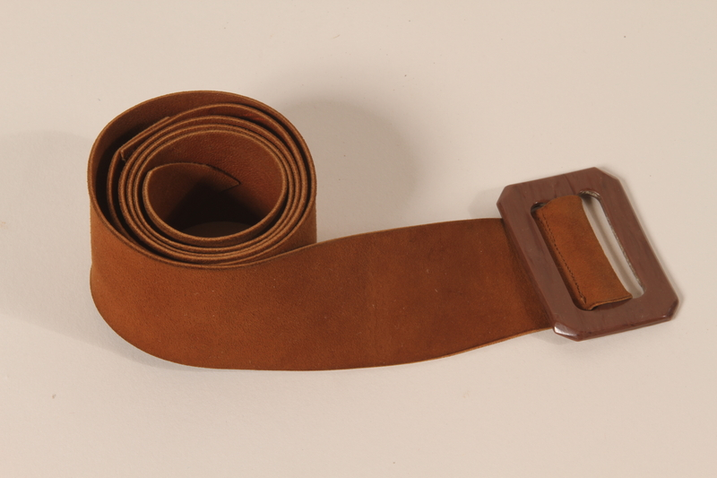 2009.376.30 front Woman's brown suede belt brought to the US by a Jewish family fleeing German occupied Poland