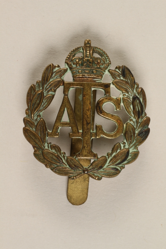 2009.294.5 front Auxiliary Territorial Service cap badge worn by an Austrian Jewish woman in the British Auxiliary