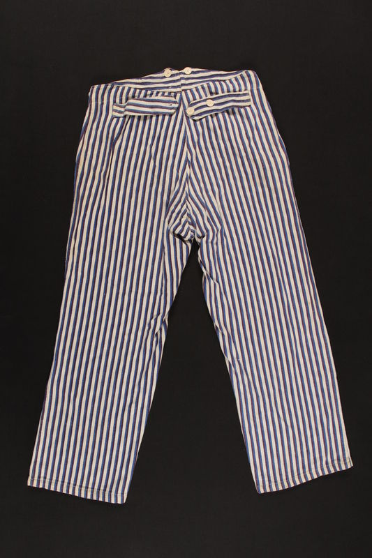 2009.396.2 back Blue striped pajama pants worn during hospital stays by soldiers serving in the German military
