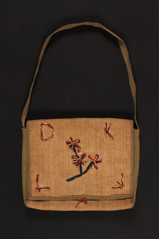 2010.194.2 front Burlap purse with yarn flowers and monogram carried by a 10 year old Jewish Austrian refugee