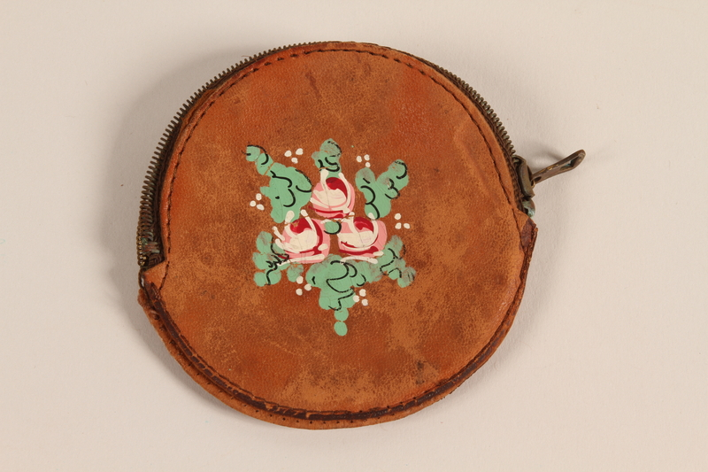 2010.194.3_a front Leather coin purse with 3 pins, a Dutch coin, and a metal key carried by a young Jewish Austrian refugee to the US