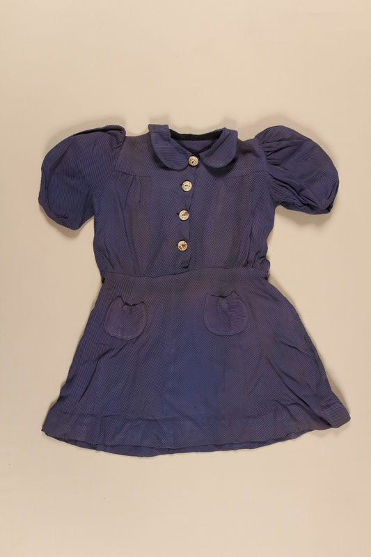 2010.194.4 front Dark blue dress with black stripes worn by a young Jewish refugee during her voyage to the US