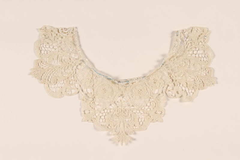 2010.194.7 front White lace collar with a rosettes worn by a young Austrian Jewish refugee to the US