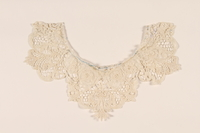 2010.194.7 front White lace collar with a rosettes worn by a young Austrian Jewish refugee to the US  Click to enlarge
