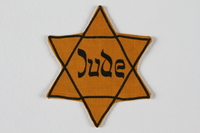 2010.200.2 front Yellow Star of David badge with Jude worn by a young German Jewish boy  Click to enlarge