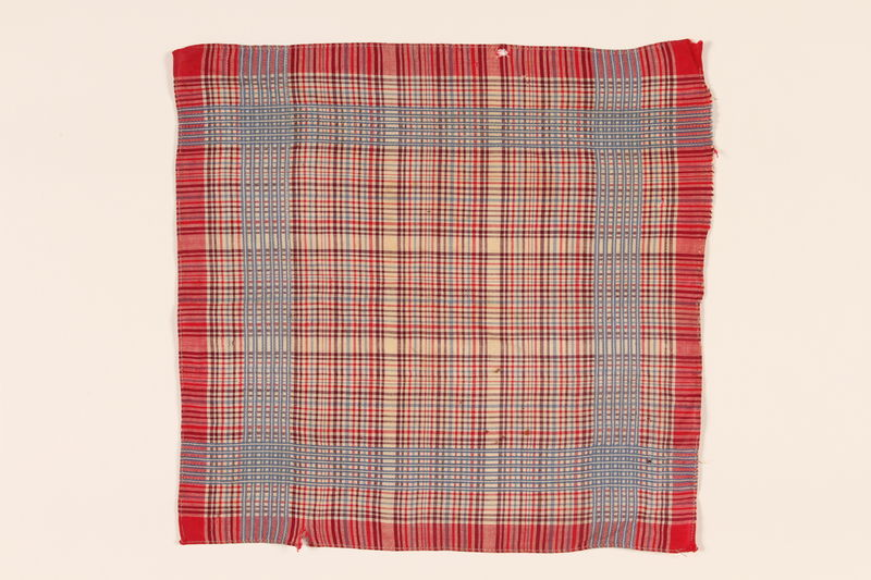 2008.228.5 front Red plaid handkerchief used in the Warsaw ghetto