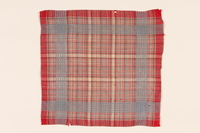 2008.228.5 front Red plaid handkerchief used in the Warsaw ghetto  Click to enlarge