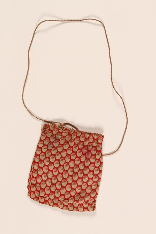 2008.228.6 front Red drawstring pouch used in the Warsaw ghetto