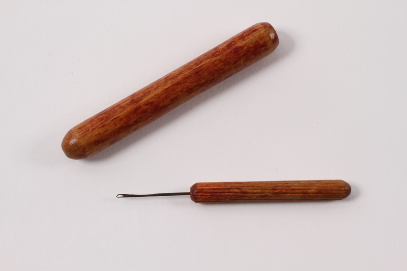2008.228.10 open Darning needle and case used in the Warsaw ghetto