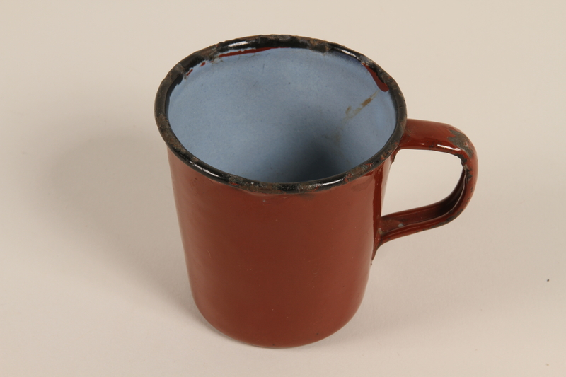 2008.228.12 front Red enamel cup used by an inmate in a slave labor camp