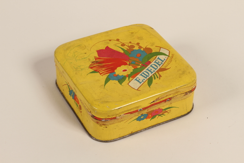 2008.228.14 front E. Wedel candy tin received in a displaced persons camp