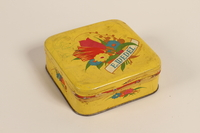 2008.228.14 front E. Wedel candy tin received in a displaced persons camp  Click to enlarge