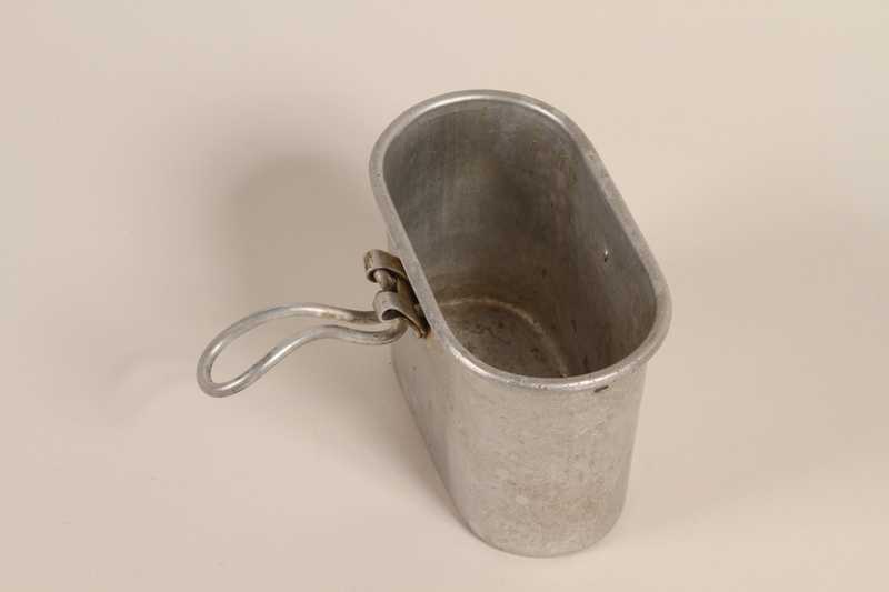 2008.228.20 front Metal soup canteen used by an inmate in a slave labor camp