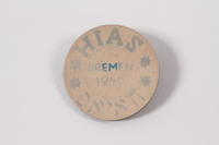 2010.416.1 a front Souvenir pin with the words HIAS and Bremen and two boxes given to a young Jewish Polish refugee  Click to enlarge