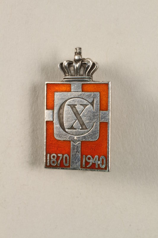 2010.417.4 front Kingmark silver and red enamel spring tension pin commemorating the 70th birthday in 1940 of King Christian X of Denmark