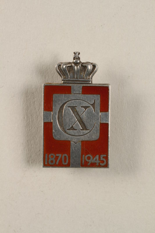2010.417.5 front Kingmark silver and red enamel pin with a buttonhole back commemorating the 75th birthday in 1945 of King Christian X of Denmark