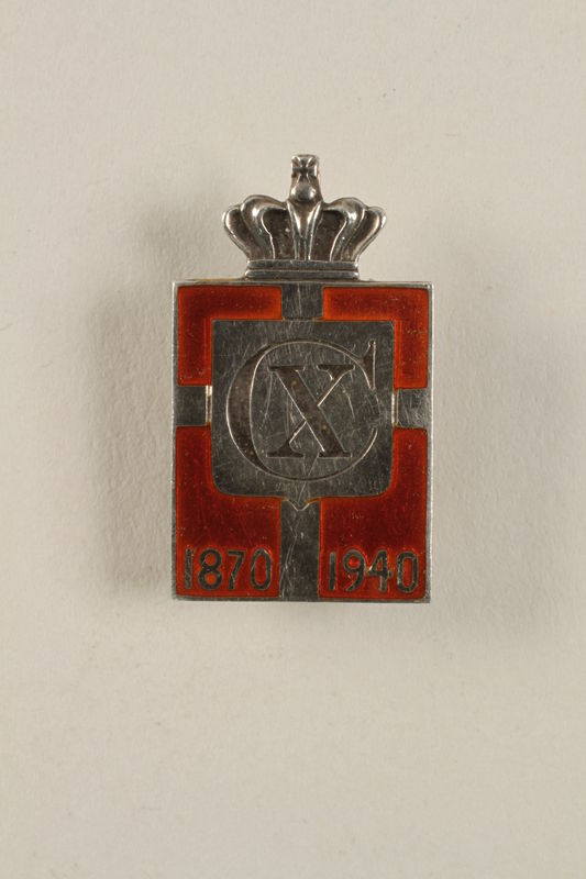 2010.417.9 front Kingmark silver and red enamel pin with a buttonhole back commemorating the 70th birthday in 1940 of King Christian X of Denmark