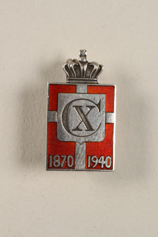 2010.417.10 front Kingmark silver and red enamel spring tension pin commemorating the 70th birthday in 1940 of King Christian X of Denmark