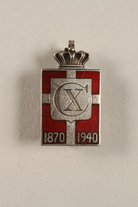 2010.417.11 front Kingmark silver and red enamel spring tension pin commemorating the 70th birthday in 1940 of King Christian X of Denmark