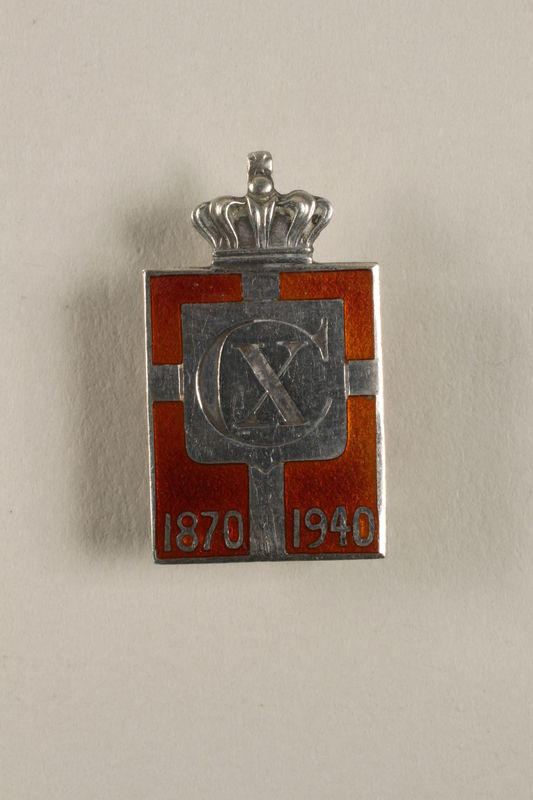 2010.417.13 front Kingmark silver and red enamel pin with a buttonhole back commemorating the 70th birthday in 1940 of King Christian X of Denmark