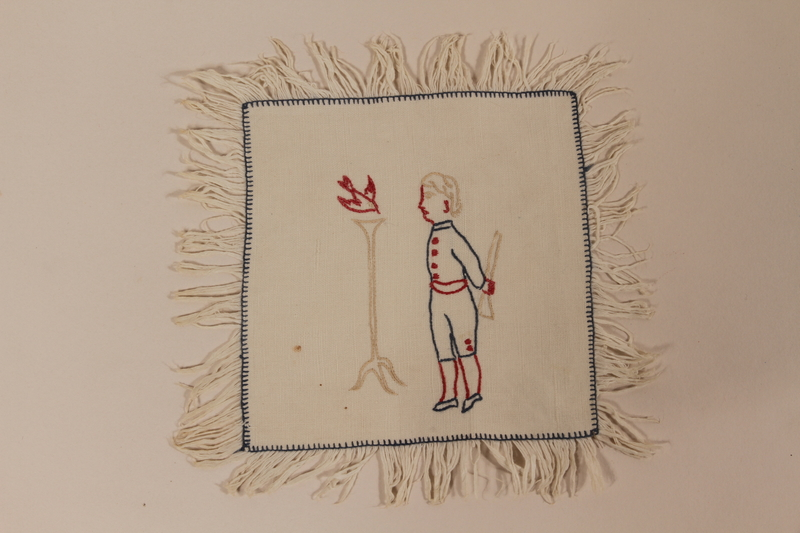 2010.442.3 front Small sampler with outline of a boy recovered by Hungarian Jewish woman