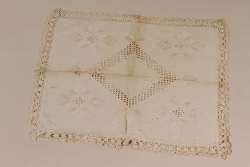 2010.442.6 front Pillow sham with elaborate whitework embroidery and a crocheted border recovered by a Hungarian Jewish woman from her neighbors