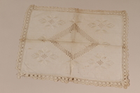2010.442.6 front Pillow sham with elaborate whitework embroidery and a crocheted border recovered by a Hungarian Jewish woman from her neighbors  Click to enlarge