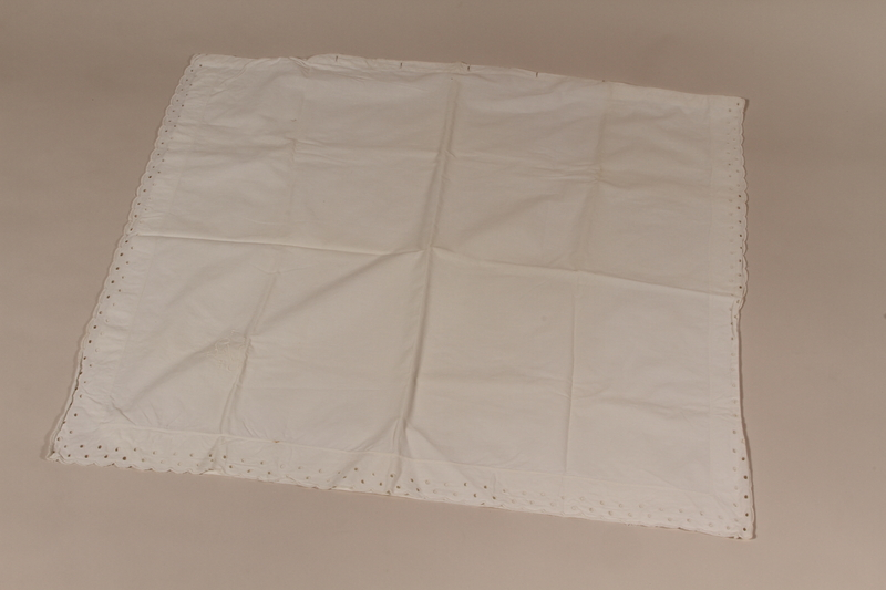 2010.442.9 front Large embroidered white pillowcase with scalloped edges recovered by a Hungarian Jewish woman after concentration camps