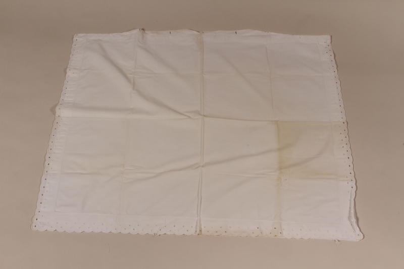2010.442.10 front Large embroidered white pillowcase with scalloped edges recovered by a Hungarian Jewish woman from her neighbors