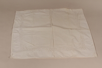2010.442.13 front Large white pillowcase embroidered with a floral design recovered by a Hungarian Jewish woman from her neighbors  Click to enlarge