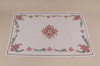 2010.442.18 front Tablecloth with an embroidered multicolored floral design recovered by a Hungarian Jewish woman from her neighbors  Click to enlarge