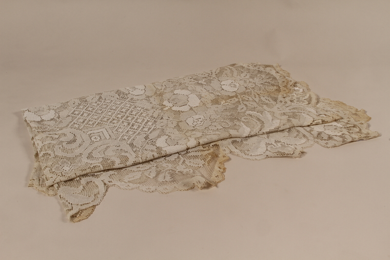 2010.442.19 front Lace tablecloth with an embroidered white floral design recovered by a Hungarian Jewish woman from her neighbors