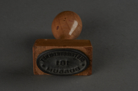 2010.441.5 front Oval rubber hand stamp with Dutch text used by a Dutch resistance member to forge identity cards  Click to enlarge