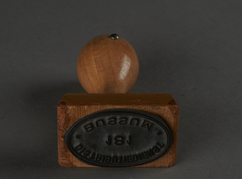 2010.441.5 bottom Oval rubber hand stamp with Dutch text used by a Dutch resistance member to forge identity cards