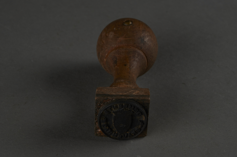 2010.441.6 front Rubber hand stamp with Gemeente Gravenhage used by a Dutch resistance forger