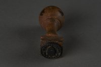 2010.441.6 back Rubber hand stamp with Gemeente Gravenhage used by a Dutch resistance forger  Click to enlarge