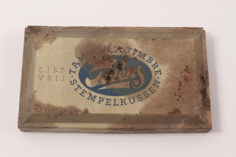 2010.441.7 top Large ink pad in a metal box used by a Dutch resistance member to forge identity cards