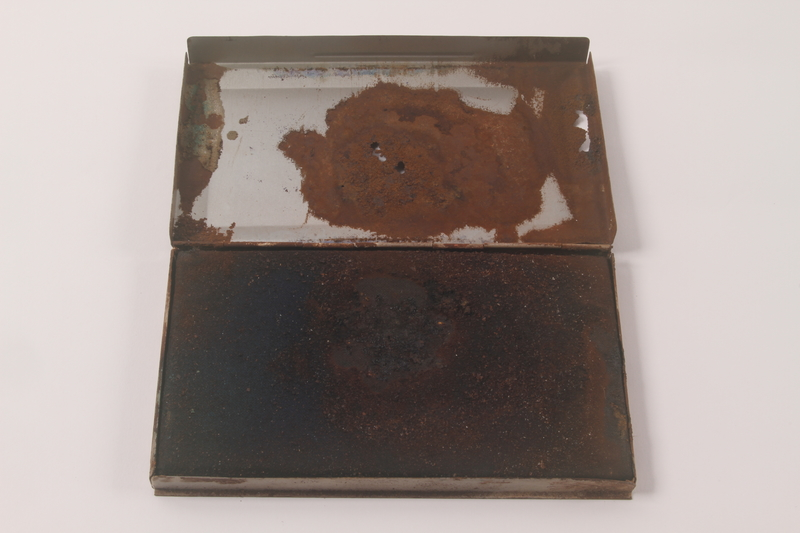 2010.441.7 open Large ink pad in a metal box used by a Dutch resistance member to forge identity cards