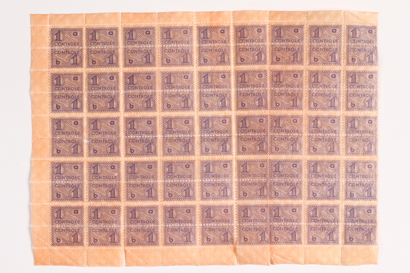 2010.441.92 front Sheet of 90 postage stamps for use by a Dutch resistance member to forge identity cards