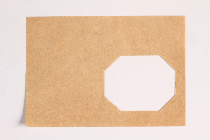 2010.441.105 front Sheet of paper with an octagonal cutout used by a Dutch resistance member who forged identity cards
