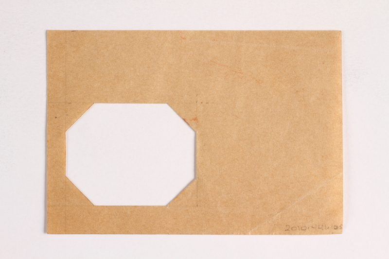 2010.441.105 back Sheet of paper with an octagonal cutout used by a Dutch resistance member who forged identity cards